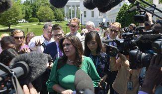 White House press secretary Sarah Huckabee Sanders speaks to reporters outside the West Wing of the White House in Washington, Friday, May 25, 2018. (AP Photo/Susan Walsh)