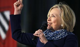 Hillary Clinton pumps her fist as she is introduced at Harvard University in Cambridge, Mass., Friday, May 25, 2018. Harvard University's Radcliffe Institute honored Clinton with the 2018 Radcliffe Medal. (AP Photo/Charles Krupa)