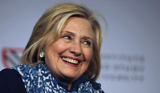 Hillary Clinton smiles as she is introduced at Harvard University in Cambridge, Mass., Friday, May 25, 2018. Harvard University's Radcliffe Institute honored Clinton with the 2018 Radcliffe Medal. (AP Photo/Charles Krupa)