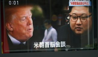 "A man is reflected on a TV screen showing North Korean leader Kim Jong Un, right, and U.S. President Donald Trump in Tokyo Friday, May 25, 2018. President Donald Trump on Thursday abruptly canceled his summit with North Korea's Kim Jong Un, blaming ""tremendous anger and open hostility"" by Pyongyang , a decision North Korea called ""regrettable"" while still holding out hope for ""peace and stability."" The Japanese, bottom, read "" Summit between U.S. and North Korea."" (AP Photo/Eugene Hoshiko)"