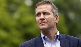 FILE - In this May 17, 2018 file photo, Missouri Gov. Eric Greitens looks on before speaking at an event near the capitol in Jefferson City, Mo. Allegations of sexual misconduct and campaign finance violations against Greitens have been shared with federal authorities by both a private attorney and a key lawmaker, according to testimony Thursday, May 24, 2018, during a legislative hearing by a special committee considering whether to recommend impeachment. (AP Photo/Jeff Roberson, File)