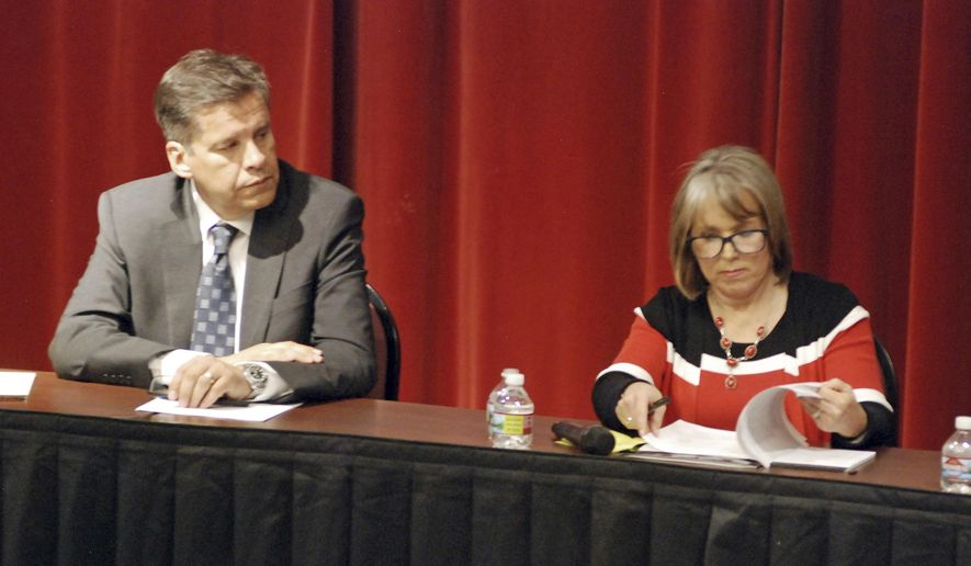 In this April 5, 2018 photo, candidates for New Mexico governor participate in a policy forum in Albuquerque, N.M., attended by state Sen. Joseph Cervantes, left, of Las Cruces, and U.S. Rep. Michelle Lujan Grisham of Albuquerque. New Mexico's next governor will inherit simmering discontent over teacher pay and evaluations, urgent calls to expand early childhood schooling and a lawsuit that may put the judiciary in charge of pivotal education funding decisions. (AP Photo/Morgan Lee)