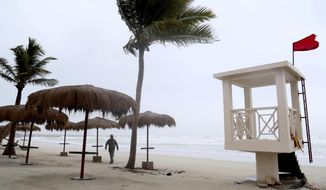 "A man walks down the stormy beach at a hotel in Salalah, Oman, Friday, May 25, 2018. Cyclone Mekunu will be ""extremely severe"" when it crashes into the Arabian Peninsula this weekend, meteorologists warned Friday, after earlier thrashing the Yemeni island of Socotra. (AP Photo/Kamran Jebreili)"
