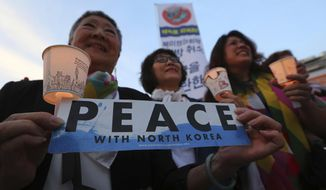 """Protesters hold candle lights during a rally to denounce the United States' policies against North Korea near the U.S. embassy in Seoul, South Korea, Friday, May 25, 2018. North Korea said Friday that it's still willing to sit down for talks with the United States """"at any time, at any format"""" just hours after President Donald Trump abruptly canceled his planned summit with the North's leader Kim Jong Un. (AP Photo/Ahn Young-joon)"""