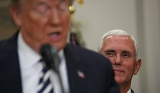 "Vice President Mike Pence listens as President Donald Trump delivers a statement on North Korea before signing the ""Economic Growth, Regulatory Relief, and Consumer Protection Act,"" in the Roosevelt Room of the White House, Thursday, May 24, 2018, in Washington. (Associated Press) **FILE**"