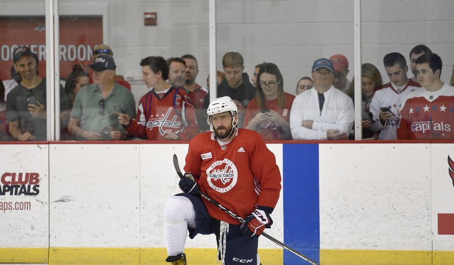 Washington Capitals left wing Alex Ovechkin, of Russia, kneels at an NHL hockey practice, Saturday, May 26, 2018, in Arlington, Va. (AP Photo/Nick Wass) *FILE**