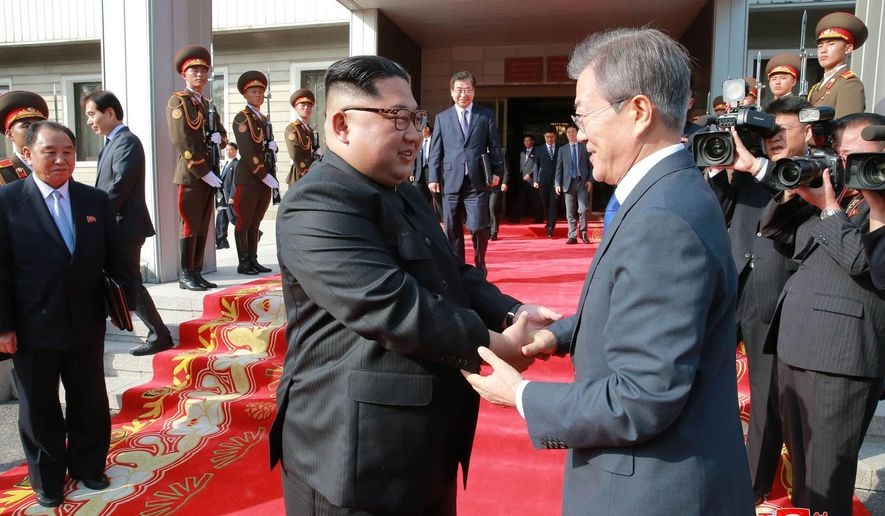 """In this May 26, 2018, photo provided on May 27, 2018, by the North Korean government, North Korean leader Kim Jong Un, left, and South Korean President Moon Jae-in, right, shake hands after their meeting at the northern side of Panmunjom in North Korea. The content of this image is as provided and cannot be independently verified. Korean language watermark on image as provided by source reads: """"KCNA"""" which is the abbreviation for Korean Central News Agency. (Korean Central News Agency/Korea News Service via AP)"""