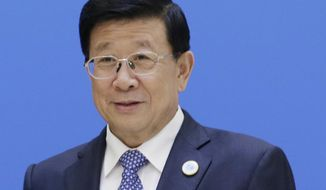 """FILE - In this May 22, 2018 file photo, China's Minister of Public Security Zhao Kezhi poses ahead of a plenary meeting of the Shanghai Cooperation Organization (SCO) security secretary summit in Beijing. Zhao has called for closer international cooperation to """"destroy the breeding ground of terrorism,"""" along with a ramping-up of already overwhelming counterterrorism measures at home. (Jason Lee/Pool Photo via AP, File)"""