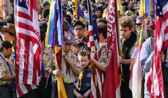 Boy Scouts and Cub Scouts gather at the Los Angeles National Cemetery in Los Angeles on Saturday, May 26, 2018. More than 6,000 scouts, with the support of local community members, placed 88,000 U.S. flags on graves throughout the cemetery to honor fallen service members in anticipation of Memorial Day. (AP Photo/Richard Vogel) ** FILE **