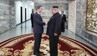 In this photo provided by South Korea Presidential Blue House via Yonhap News Agency, North Korean leader Kim Jong Un, right, and South Korean President Moon Jae-in, left, shake hands before their meeting at the northern side of the Panmunjom in North Korea, Saturday, May 26, 2018. Kim and Moon have met for the second time in a month to discuss peace commitments they reached in their first summit and Kim's potential meeting with President Donald Trump. (South Korea Presidential Blue House/Yonhap via AP)