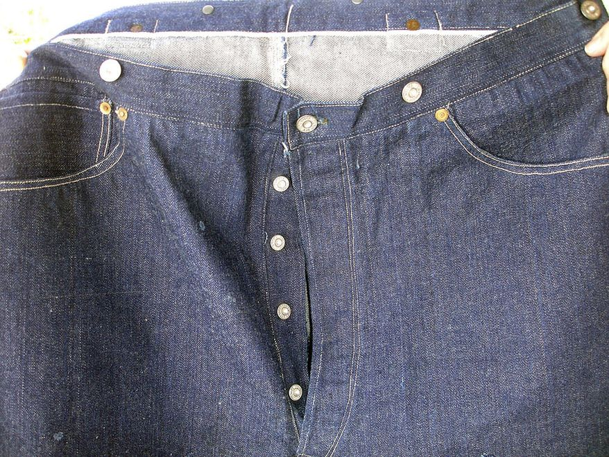 This undated photo provided by Daniel Buck Auctions, of Lisbon Falls, Maine, shows a portion of a pair of 125-year-old Levi Strauss & Co., denim blue jeans that sold for nearly $100,000 this in May 2018 to a buyer in Asia. The jeans were purchased in 1893 by a store keeper in the Arizona Territory and were in pristine condition because they were worn only a few times. (Daniel Buck Soules/Daniel Buck Auctions via AP) ** FILE **