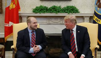 """You've gone through a lot,"" said President Trump to Joshua Holt, who was recently released from a prison in Venezuela. ""A lot more than people can endure,"" he said. (Associated Press photographs)"