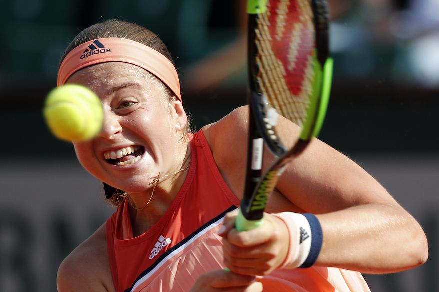 Latvia's Jelena Ostapenko returns the ball to Ukraine's Kateryna Kozlova during their first round match of French Open tennis tournament at the Roland Garros Stadium, Sunday, May 27, 2018 in Paris. (AP Photo/Christophe Ena)