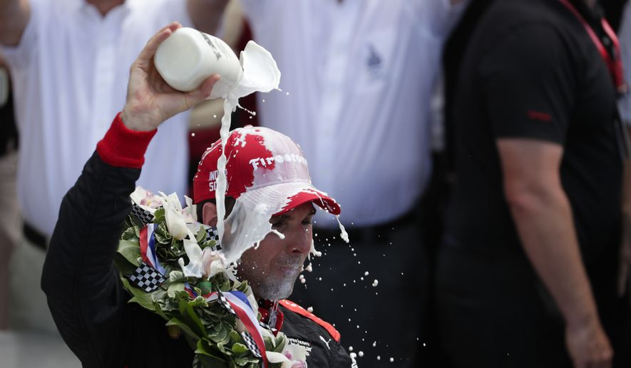 Will Power, of Australia, celebrates after winning the Indianapolis 500 auto race at Indianapolis Motor Speedway, in Indianapolis Sunday, May 27, 2018. (AP Photo/Michael Conroy)
