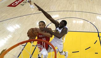 Houston Rockets guard Eric Gordon (10) shoots against Golden State Warriors forward Draymond Green (23) during the second half of Game 6 of the NBA basketball Western Conference Finals in Oakland, Calif., Saturday, May 26, 2018. The Warriors won 115-86. (John G. Mabanglo/Pool Photo via AP)