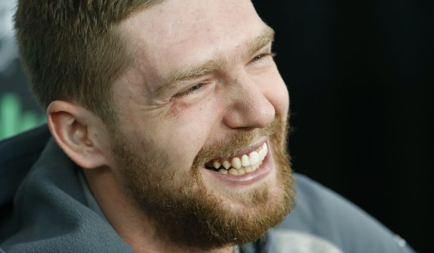 Washington Capitals center Evgeny Kuznetsov laughs while speaking with the media during an NHL hockey media day for the Stanley Cup, Sunday, May 27, 2018, in Las Vegas. (AP Photo/John Locher)