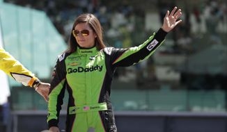 Danica Patrick waves as she's introduced before the start of the Indianapolis 500 auto race at Indianapolis Motor Speedway, in Indianapolis Sunday, May 27, 2018. (AP Photo/Michael Conroy)