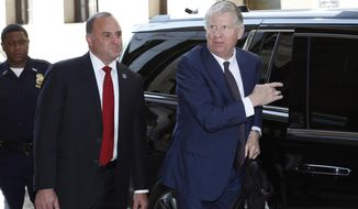 FILE- In this May 25, 2018 file photo, New York County District Attorney Cyrus Vance Jr., right, arrives at New York County Criminal Court, in New York from the arraignment of former entertainment mogul Harvey Weinstein on rape and other charges. Vance has been under a microscope over his office's handling of past sex assault cases involving powerful men. A state investigation has been examining how Vance handled and decided not to prosecute a groping allegation against Weinstein three years ago. Women's-rights activists have protested outside Vance's office. (AP Photo/Mark Lennihan, File)