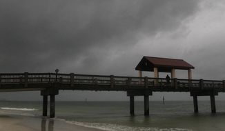 Rain falls on Clearwater Beach by Pier 60 early Sunday morning, May 27, 2018, as northbound Subtropical Storm Alberto looms in the gulf to the southwest.  (Jim Damaske/Tampa Bay Times via AP)