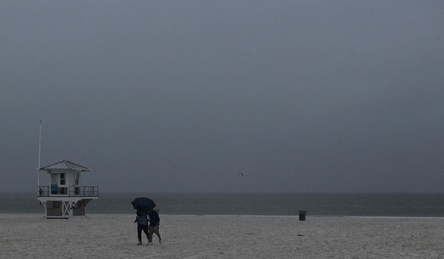 Rain falls on Clearwater Beach by Pier 60 early Sunday morning May 27, 2018, as northbound Subtropical Storm Alberto looms in the gulf to the southwest. as northbound Subtropical Storm Alberto looms in the gulf to the southwest. (Jim Damaske/Tampa Bay Times via AP)