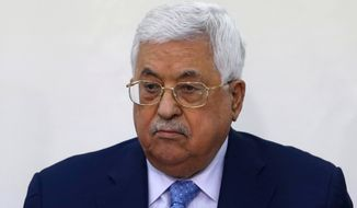 In this March 1, 2018, file photo, Palestinian President Mahmoud Abbas attends a meeting of the Fatah Revolutionary Council in the West Bank city of Ramallah. Abbas was discharged Monday, May 28, 2018, from a West Bank hospital more than a week after he was hospitalized for fever and pneumonia. (AP Photo/Majdi Mohammed, File)