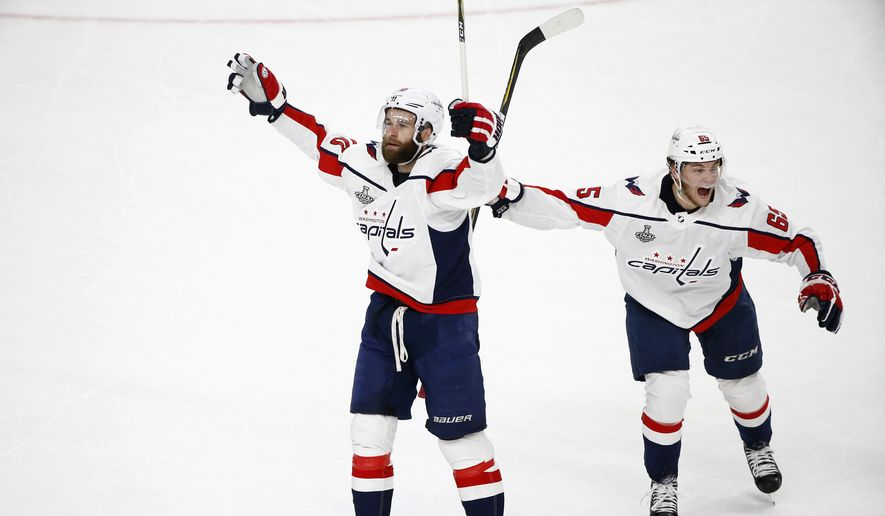 Washington Capitals right wing Brett Connolly, left, celebrates his goal with left wing Andre Burakovsky, of Austria, during first period in Game 1 of the NHL hockey Stanley Cup Finals against the Vegas Golden Knights Monday, May 28, 2018, in Las Vegas. (AP Photo/Ross D. Franklin)