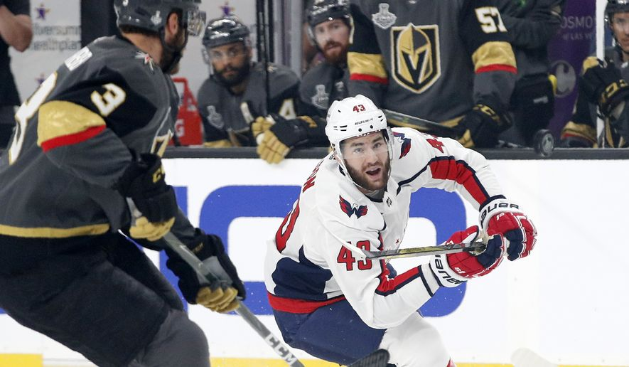 Washington Capitals right wing Tom Wilson, right, tries to knock the puck out of the air and away from Vegas Golden Knights defenseman Brayden McNabb during first period in Game 1 of the NHL hockey Stanley Cup Finals, Monday, May 28, 2018, in Las Vegas. (AP Photo/John Locher) ** FILE **