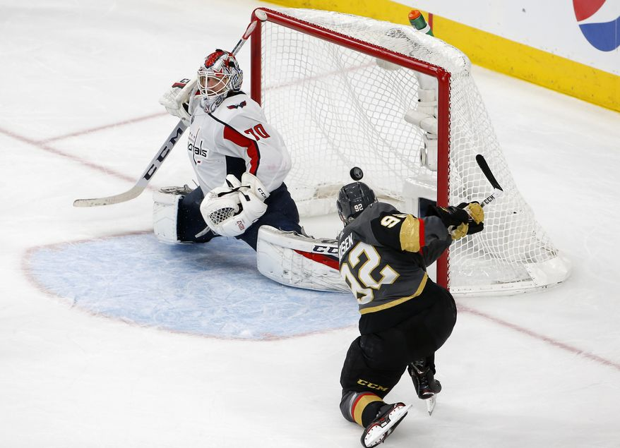 Washington Capitals goaltender Braden Holtby, left, is scored on by Vegas Golden Knights left wing Tomas Nosek, of the Czech Republic, during the third period in Game 1 of the NHL hockey Stanley Cup Finals Monday, May 28, 2018, in Las Vegas. (AP Photo/Ross D. Franklin)