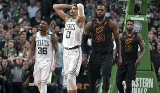 Boston Celtics guard Marcus Smart (36) and forward Jayson Tatum (0) react in front of Cleveland Cavaliers forward LeBron James (23) during the second half in Game 7 of the NBA basketball Eastern Conference finals, Sunday, May 27, 2018, in Boston. (AP Photo/Elise Amendola) **FILE**