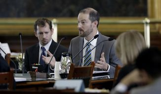 In this Feb. 26, 2018, photo, David J. Hacker, special counsel for litigation for the Texas attorney general's office, right, and Brantley Starr, deputy first attorney general, left, take part in a committee meeting on religious freedom laws at the Texas Capitol, in Austin, Texas. Lawyers who espouse a conservative Christian agenda have been growing in influence since the Trump administration took office. (AP Photo/Eric Gay)