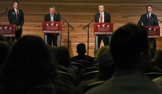 FILE - This March 22, 2018 file photo shows candidates for the Republican nomination to U.S. Senate, from left, Russell Fagg, Troy Downing, Matt Rosendale and Albert Olszewski listen to a question posed by a moderator belonging to the College Republicans at Montana State University in Bozeman, Mont. Outside money has poured into Montana's Republican U.S. Senate primary that will decide the challenger for Democratic incumbent Jon Tester. (Rachel Leathe/Bozeman Daily Chronicle via AP, File)