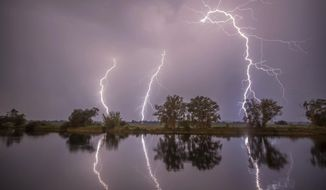 In this May 27, 2018 photo thunderbolts are reflected near Premnitz, eastern Germany. (Julian Staehle/dpa via AP)