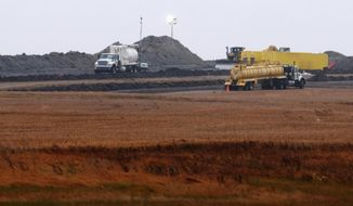 FILE - This Oct. 11, 2013, file photo shows cleanup at the site of a Tesoro Corp. pipeline break that spilled more than 20,000 barrels of oil into a Tioga, N.D., wheat field. Nearly five years after a North Dakota farmer discovered oil oozing into his wheat field, cleanup of what turned out to be a massive spill is nearly complete. It cost some $93 million to excavate and clean the soil devastated by the pipeline break that may have been caused by a lightning strike. (AP Photo/Kevin Cederstrom, File)