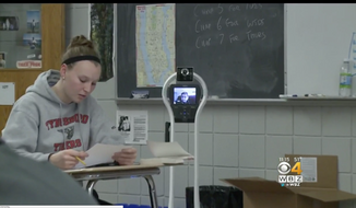 13-year-old Keegan Concannon, who has an immunodeficiency disorder and makes it to class less than half the time, won the right to use his robot as part of a settlement under the Americans with Disabilities Act. (WBZ-TV screenshot)