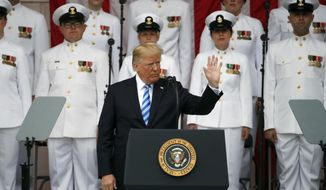 President Donald Trump gestures while speaking at the Memorial Amphitheater in Arlington National Cemetery on Memorial Day, Monday, May 28, 2018 in Arlington, Va.(AP Photo/Alex Brandon)