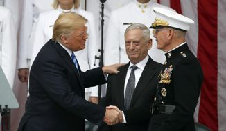 President Donald Trump shakes hands with Joint Chiefs Chairman Gen. Joseph Dunford, right, with Defense Secretary Jim Mattis in the center, at the Memorial Amphitheater in Arlington National Cemetery on Memorial Day, Monday, May 28, 2018 in Arlington, Va.(AP Photo/Alex Brandon)