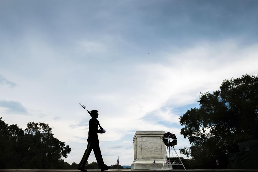 A member of the U.S. Army 3rd Infantry Regiment walks his post in front of The Tomb of the Unknown Soldier in Arlington National Cemetery during the Memorial Day weekend in Arlington, Va., Sunday, May 27, 2018. (AP Photo/J. David Ake)