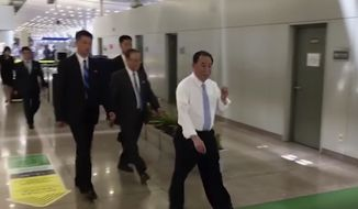 In this image made from video, Kim Yong-chol, in white, a former military intelligence chief who is now Kim Jong-un's top official on inter-Korean relations, walks upon arrival at Beijing airport in Beijing Tuesday, May 29, 2018. (AP Photo)