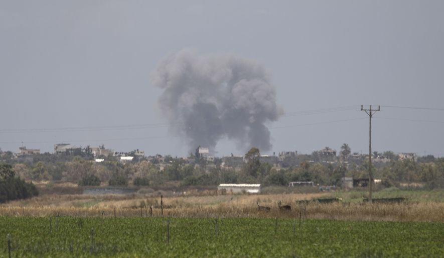 Smoke rises following an Israeli airstrike in the south Gaza Strip, as seen from the Israeli side of the border, Tuesday, May 29, 2018. Israeli jets bombed Gaza hours after militants from the territory on Tuesday fired more than 25 mortar shells toward communities in southern Israel in what appeared to be the largest single barrage since the 2014 Israel-Hamas war. (AP Photo/Tsafrir Abayov)