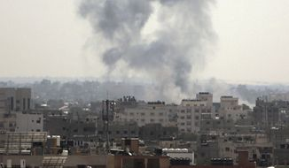 Smoke raise flowing an Israeli airstrike on Gaza City, Tuesday, May 29, 2018. Israeli jets bombed Gaza hours after militants from the territory on Tuesday fired more than 25 mortar shells toward communities in southern Israel in what appeared to be the largest single barrage since the 2014 Israel-Hamas war. (AP Photo/Khalil Hamra)