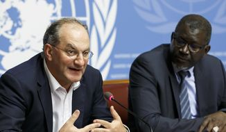 Peter Salama, left, deputy director-general for Emergency Preparedness and Response of WHO, sits next to Secretary General of the International Federation of Red Cross and Red Crescent Societies (IFRC) Elhadj As Sy, right, as they inform the media about IFRC's and WHO's response on Ebola cases in the Democratic Republic of the Congo, during a press conference, at the European headquarters of the United Nations in Geneva, Switzerland, Tuesday, May 29, 2018. (Salvatore Di Nolfi/Keystone via AP)
