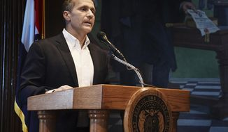 Missouri Gov. Eric Greitens reads from a prepared statement as he announces his resignation during a news conference, Tuesday, May 29, 2018, at the state Capitol, in Jefferson City, Mo. Greitens resigned amid a widening investigation that arose from an affair with his former hairdresser. Greitens said his resignation would take effect Friday. (Julie Smith/The Jefferson City News-Tribune via AP)
