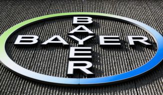 This Monday, May 23, 2016, file photo, shows the Bayer AG corporate logo displayed on a building of the German drug and chemicals company in Berlin. (AP Photo/Markus Schreiber, File)
