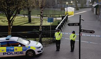 "FILE - In this Wednesday, March 7, 2018 file photo, police officers guard a cordon around a police tent covering the the spot where former Russian double agent Sergei Skripal and his daughter were found critically ill following exposure to an ""unknown substance"" in Salisbury, England. Doctors who treated poisoned ex-spy Sergei Skripal and his daughter Yulia say they don't know what their long-term prognosis is. The pair were found unconscious in the English city of Salisbury March 4 after being exposed to a nerve agent known as Novichok. (AP Photo/Matt Dunham, File)"