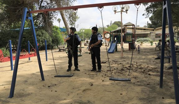 Israeli police officers guarded a playground near the Israel and Gaza border last month after Gaza militants fired more than 25 mortar shells toward communities in the south. The Israeli military said it appeared to be the largest single barrage fired since the 2014 Israel-Hamas war. (Associated Press)