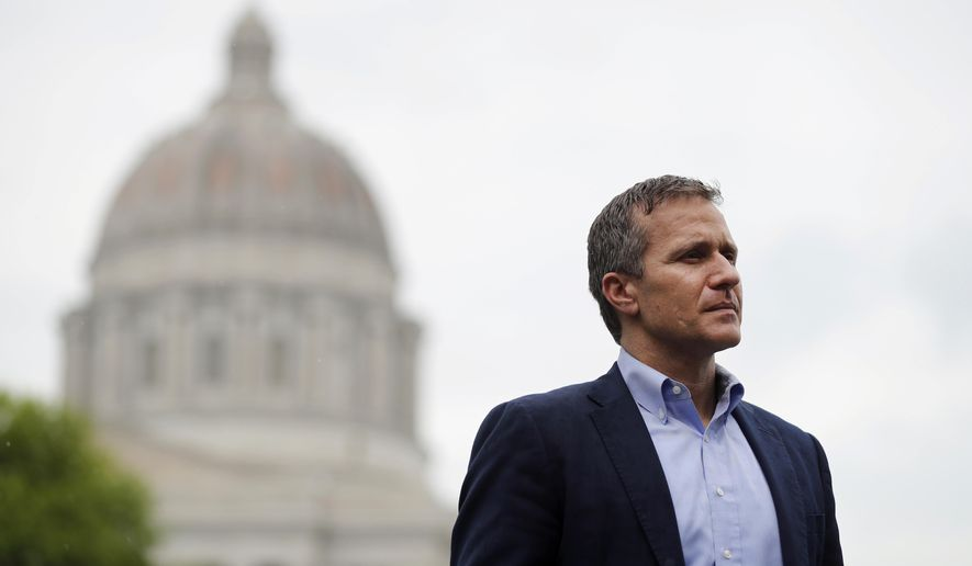In this May 17, 2018 file photo, then-Missouri Gov. Eric Greitens looks on before speaking at an event near the capitol in Jefferson City, Mo. He resigned in June 2018 after growing calls for him to step down in light of sexual assault allegations. A former Navy SEAL, Mr. Greitens has returned to Navy service, stationed in St. Louis as an officer assigned to the Navy Operation Support Center there. (AP Photo/Jeff Roberson, File) **FILE**