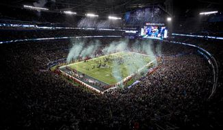 """FILE - In this Feb. 4, 2018 file photo, the Philadelphia Eagles celebrate their 41-33 win over the New England Patriots at the NFL Super Bowl 52 football game, in Minneapolis. The frigid Super Bowl brought $370 million in net new spending to the """"Bold North"""" Twin Cities area, according to a report released Tuesday, May 29, 2018, by Gov. Mark Dayton's office and the local host committee. The final tally by Rockport Analytics came in $50 million over the consulting company's pre-Super Bowl projections. (AP Photo/Bruce Kluckhohn File)"""