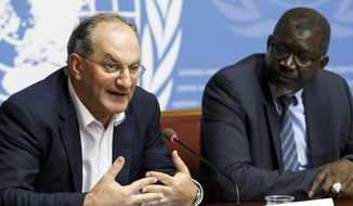 Peter Salama, left, Deputy Director-General for Emergency Preparedness and Response of WHO, sits next to Secretary General of the International Federation of Red Cross and Red Crescent Societies (IFRC), Elhadj As Sy, right, as they inform the media about IFRC's and WHO's response on ebola cases in the Democratic Republic of the Congo, during a press conference, at the European headquarters of the United Nations in Geneva, Switzerland, Tuesday, May 29, 2018. (Salvatore Di Nolfi/Keystone via AP)