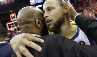 Golden State Warriors guard Stephen Curry, right, celebrates after they defeated the Houston Rockets in Game 7 of the NBA basketball Western Conference finals, Monday, May 28, 2018, in Houston. (AP Photo/David J. Phillip)