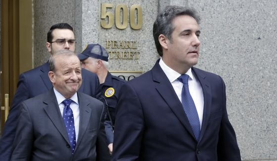 President Donald Trump's personal attorney Michael Cohen, right, leaves Federal Court, in New York, Wednesday, May 30, 2018. Cohen's attorney Stephen Ryan is at left. (AP Photo/Richard Drew)